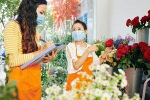 Florists discussing flowers